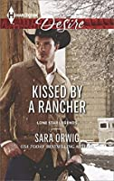 Kissed by a Rancher (Lone Star Legends)
