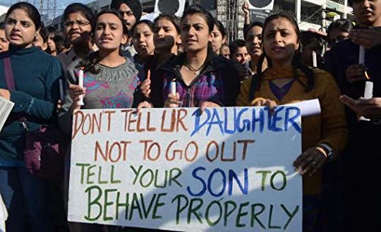 protesters holding a sign that says 'don't tell your daughter not to go out, tell your son to behave properly'