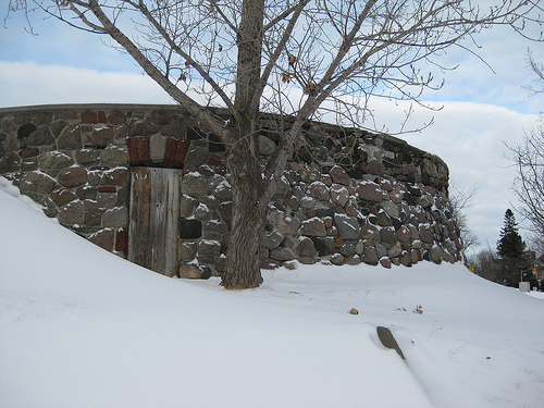 A mysterious door set into a hill.