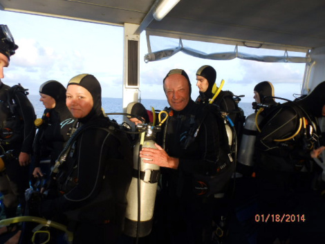 Stinger suits on, gear checked by dive 'buddy,' ready to jump off the duckboard into the water.
