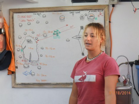 Instructor Chloe briefing on next dive