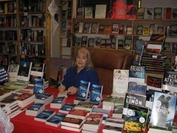 I really am an author! This is me signing books at Seattle Mystery Bookshop