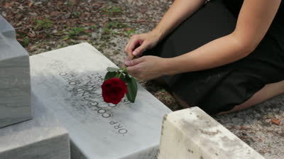 photo stock-footage-female-holding-a-rose-while-kneeling-at-a-grave-close_zpsed48d298.jpg