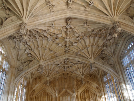 Vaulted ceiling, miniature sculpture figures of medieval characters at junctions.