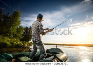 stock-photo-mature-man-fishing-from-the-boat-on-the-pond-at-sunset-200628791