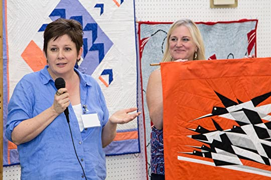 Author Frances O'Roark Dowell (l.) celebrated the launch of Birds in the Air (Milton Falls Media, Sept.) with a trunk show and book signing on Saturday, Sept. 24, 2016, at the annual meeting of the Atlanta-area's Chattahoochee Evening Stars Quilt Guild. The show featured a number of quilts by Dowell (Dovey Coe, The Secret Language of Girls, Trouble the Water) incorporating variations on the traditional Birds in the Air quilt block, a central element in her new novel -- her first for adult readers.