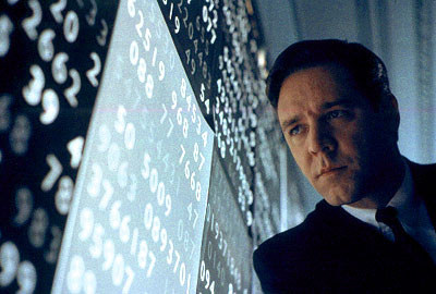 Russell Crowe looking intently at a bunch of numbers