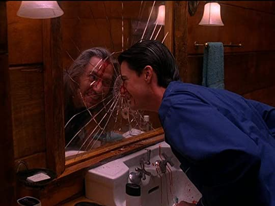 Dale Palmer bashing his head against a mirror and looking at a reflection of Bob