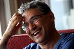 Picture dated 04 July 2005 shows Turkish novelist Orhan Pamuk laughing during an interview in Istanbul, Turkey. Orhan Pamuk, who won the Nobel Prize for Literature on Thursday 12 October 2006, is today Turkey\'s leading novelist, by far its most famous both within Turkey and in the wider world. EPA/TOLGA BOZOGLU