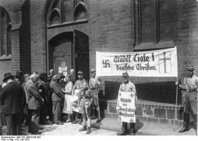 Stormtroopers holding Deutsche Christen propaganda during the Church Council elections
