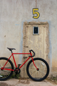 http://www.dreamstime.com/stock-photo-red-bicycle-backdrop-old-door-image42210530