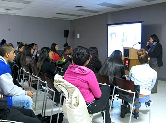 The audience at LaGuardia College listens at the
