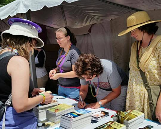 Dena looks on while Jean signs her novel and I...stare at something.