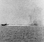 Photograph taken from USS Maddox (DD-731) during her engagement with three North Vietnamese motor torpedo boats in the Gulf of Tonkin, 2 August 1964. (Courtesy of the U.S. Naval Historical Cente)r