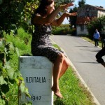 Elena Orzan is an expert on wines from northeast Italy. In this photo, she is sitting on the border of Italy and Slovenia.