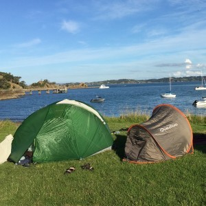 Camping at amazing Home Bay on Motutapu Island, Auckland
