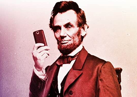 Lincoln with a cell phone