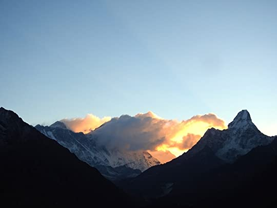 Mount Everest (left) at sunrise. Ama Dablam is on the right. Lhotse is hidden by clouds.