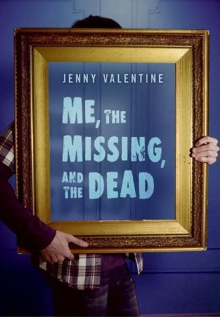 Cover of the book, Me, the Missing, and the Dead byJenny Valentine, showing a person holding a photo frame in front of their body.