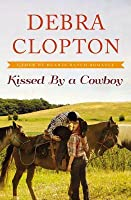 Kissed by a Cowboy (Four of Hearts Ranch, #3)