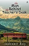 the man behind the teacher's desk