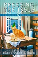 Pressing the Issue (Cookbook Nook Mystery #6)