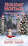 Holiday Hostage (Zoe Donovan Cozy Mystery, #31)