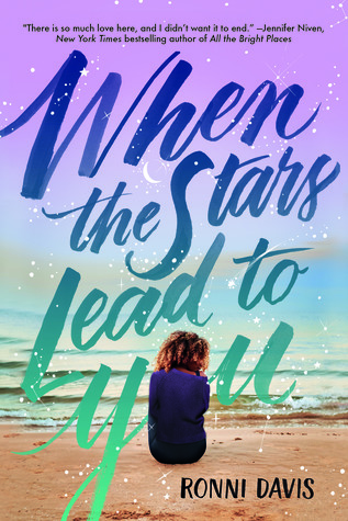 Title of novel When the Starrs Lead to You overlaid a young woman with curly black/brown hair with her back to the reader. She sits on a beach facing the water