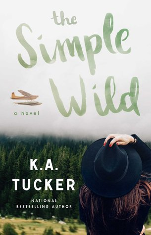 The Simple Wild book cover by K.A. Tucker. A young woman's back as she's looking into a large field with a forest beyond it.