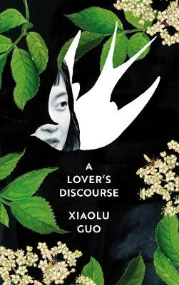 A woman's face shown through the silhouette of a bird amidst leaves and flowers on the cover of A Lover's Discourse by Xiaolu Guo