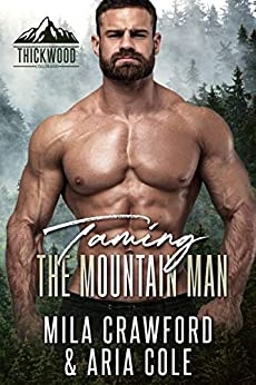Taming The Mountain Man by Mila Crawford and Aria Cole