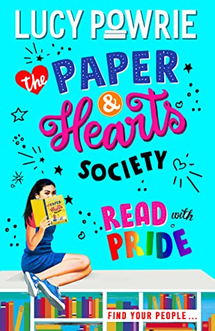 Cover for Read with Pride, showing a girl sitting on top of a rainbow bookshelf holding a book.