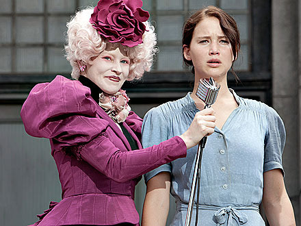 effie trinket looking crazy while she calls Katniss to the Hunger Games