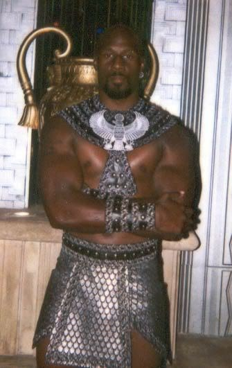 A very large, muscular, and imposing picture of a man in studded armour.