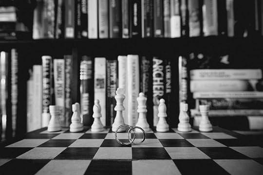Wedding rings on chess board
