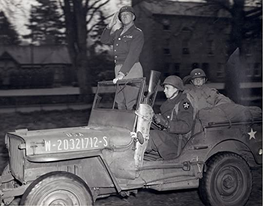 Lt. Gen. Patton with Maj. Gen. Walter Robertson pass in review of Third Army Troops in April 1944 prior to the Normandy invasion in June. US Army Photo