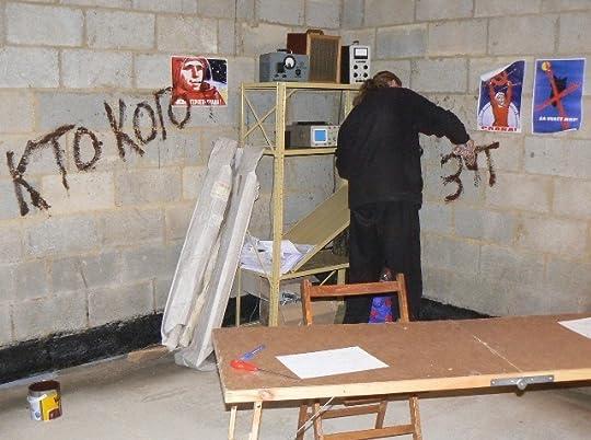 Painting Russian graffiti on the set.