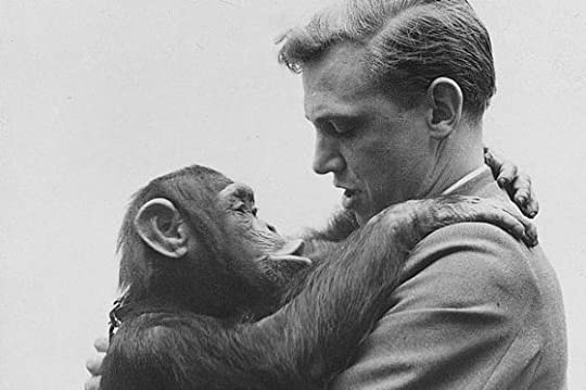 David Attenborough and a baby chimpanzee