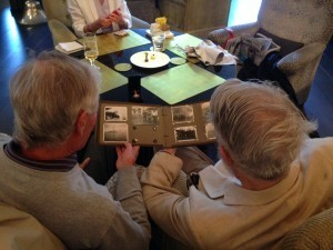 Courtenay Wright and Peter Jackson looking at Peter's father's WW II photos