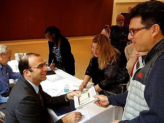 Dr. Joel M. Hoffman signing books in Brownsville, TX