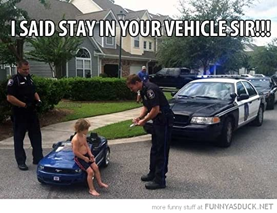 photo funny-kid-boy-toy-car-cops-police-pulled-over-stay-in-sir-pics1_zpszrap5fnm.jpg