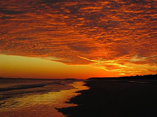 Bright orange skies from El CORAZON ISLAND