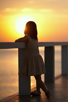 little girl watching the sunset on dock - Google Search