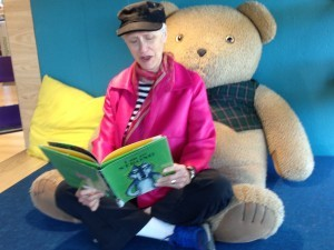 Reading in a children's cubbyhole in the Lawrence Public Library