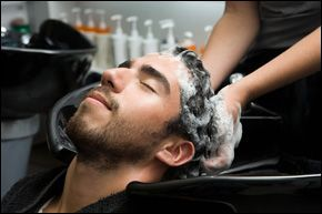washing a man's hair in salon