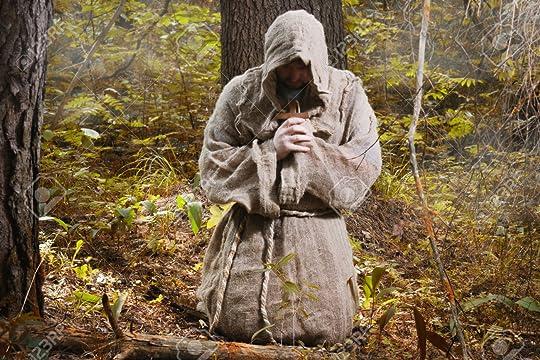 Medieval monk praying