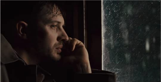 Leo looking at a rain-splattered window