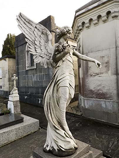 angel statue in cemetery:
