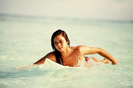 Hawaiian girl surfing: