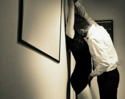 photo couple against the wall_zpsay1ppyv0.jpg
